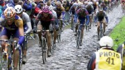 Riders steer their bikes on a cobblestone-paved section of the 100th edition of the Paris-Roubaix cycling classic, in Roubaix, northern France,  Sunday April 14, 2002. (AP Photo/Michel Spingler).