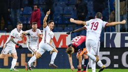 Milan's Portuguese forward Andre Silva (3rd from left) celebrates with team-mates Italian defender Alessio Romagnoli, Italian forward Patrick Cutrone and Italian defender Leonardo Bonucci after scoring a goal with a last-minute header during the Italian Serie A soccer match Genoa Cfc vs Ac Milan at Luigi Ferraris Stadium in Genoa, Italy, 11 March 2018 ANSA/SIMONE ARVEDA